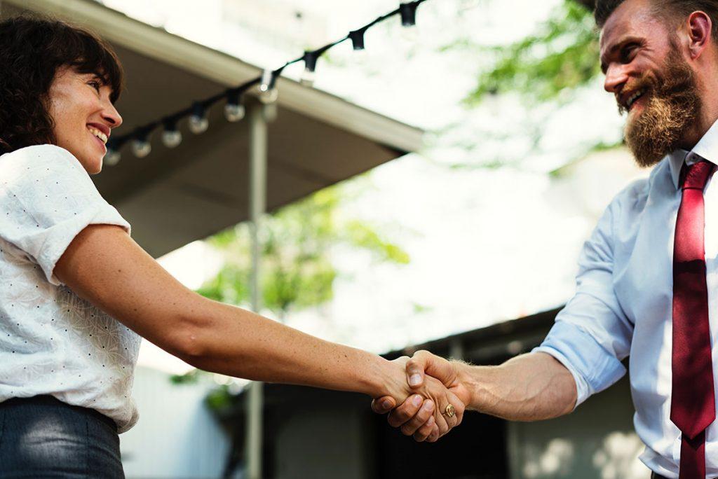 Professional handshake closing a successful mortgage loan renewal with dream key mortgage toronto
