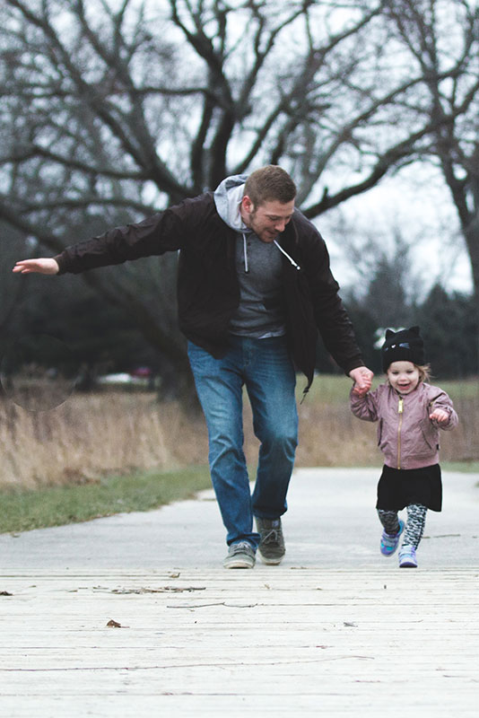 First time homebuyers - Toronto Father Daughter running through woods - Dream Key Mortgage